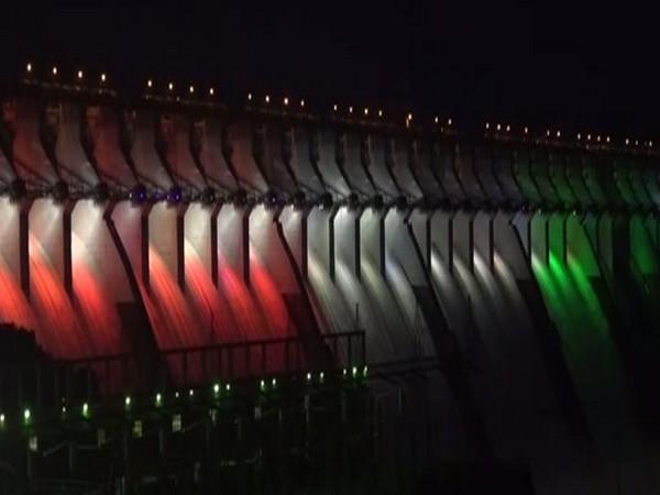 Sardar Sarovar dam lit with bright colour on Monday night. (Photo/ANI)