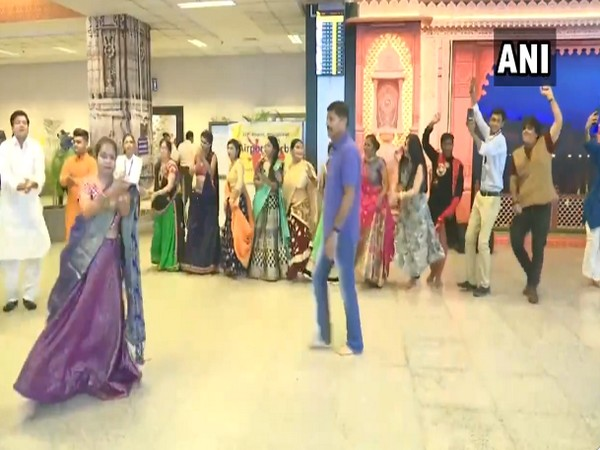 Staff and passengers perfom Garba at the Ahmedabad airport. Photo/ANI