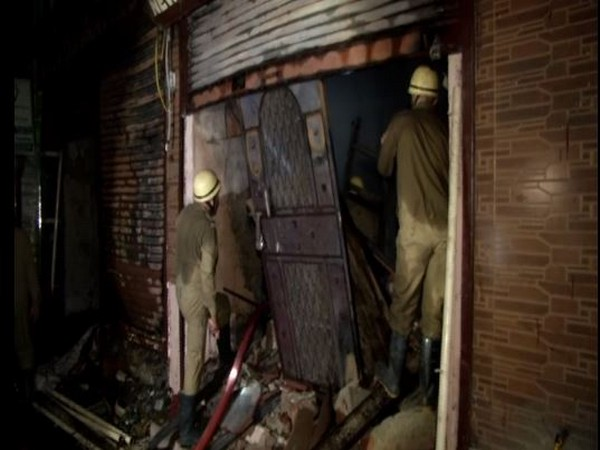 Fire department personnel at the spot in Daryaganj on Wednesday. Photo/ANI