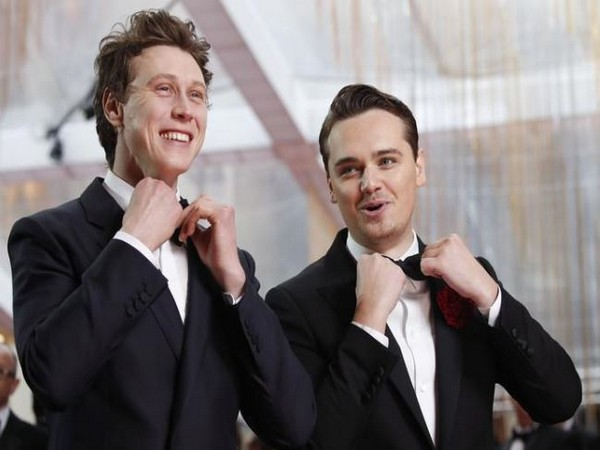 George MacKay and Dean Charles at the 92nd Oscars
