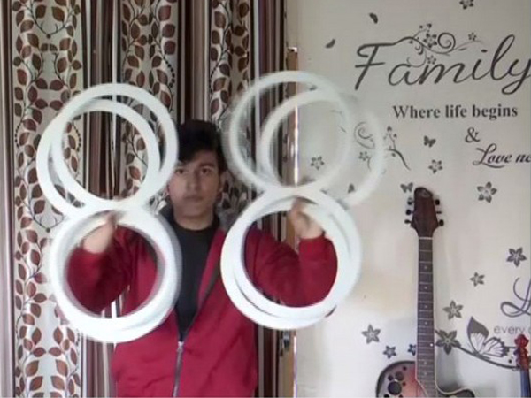 Ashish Kandwal performing ring illusion at his home in Dehradun, Uttarakhand, on Sunday. Photo/ANI