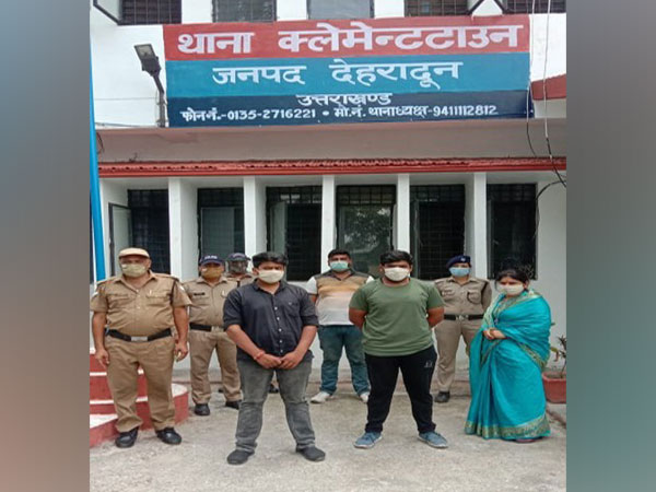 Uttarakhand BJP Mahila Morcha secretary with her sons at Clement Town police station. (Photo/ANI)