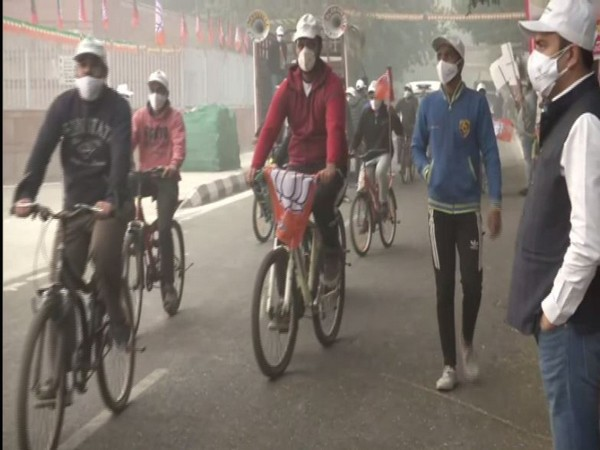 Delhi BJP Yuva Morcha members at the cycle rally on Monday. (Photo/ANI)