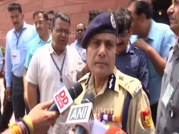 Delhi Police Commissioner Amulya Patnaik speaking to reporters in New Delhi on Wednesday.