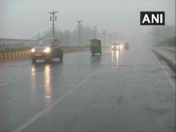 Delhi receives mild showers, visuals from INA flyover