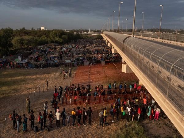 Migrants in Del Rio, Texas. (Photo Credit - Reuters)