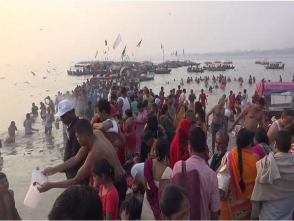 Devotees taking a holy dip at Sangam, Prayagraj. Photo/ANI