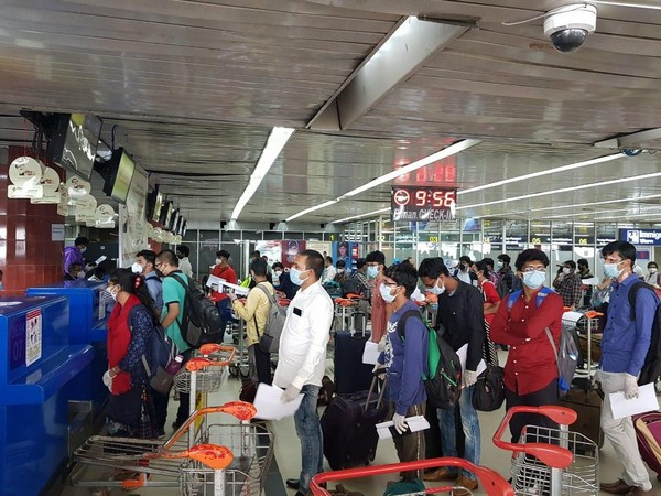 People queue at Dhaka airport to board the special flight to Kolkata on Monday morning.