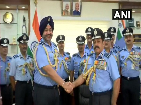 Air Chief Marshal BS Dhanoa with the new IAF Chief of Staff Air Marshal RKS Bhadauria in New Delhi on Monday. Photo/ANI