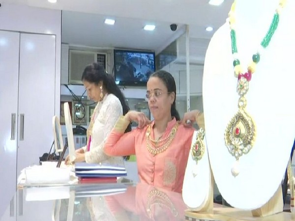 Customers selecting jewellery on the occasion of Dhanteras.
