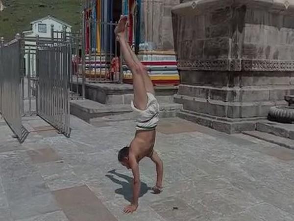 Acharya Santosh Trivedi of Kedarnath Dham performing a handstand yoga mudra in the Kedarnath temple on Sunday.