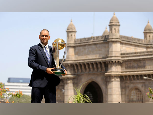 MS Dhoni with the 2011 World Cup trophy (Reuters image)