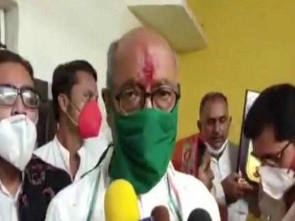 Congress leader Digvijaya Singh speaking to reporters in Ashoknagar, MP on Wednesday. [Photo/ANI]