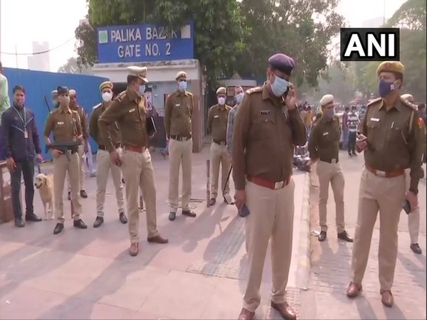 Delhi Police personnel monitoring security at Palika Bazar in Delhi.