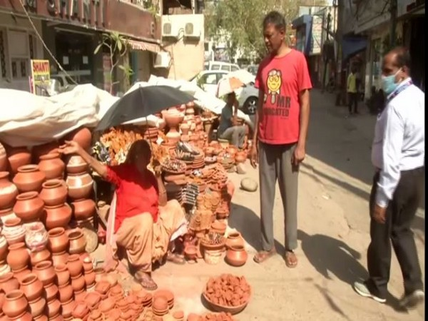A Woman sells earthen lamps in Delhi on Sunday. Photo/ANI
