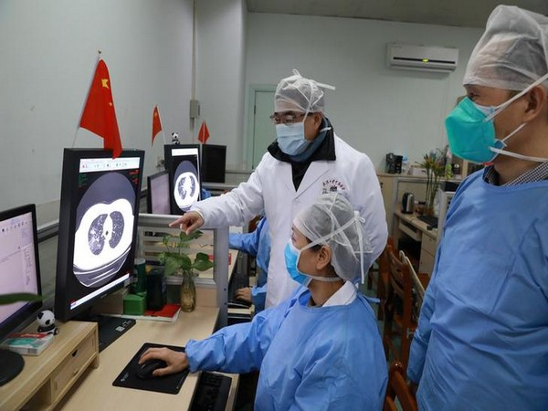 Medical workers inspect the CT scan image of a patient at the Zhongnan Hospital of Wuhan University following an outbreak of the new coronavirus in Wuhan.