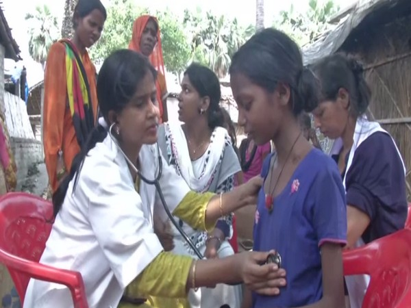 Visuals of doctor examining a children in Vaishali's Harivanshpur village, Bihar on Thursday. Photo/ANI
