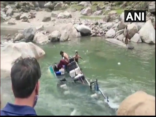 A minibus skidded off a mountainous road and fell into a river in the Doda district in Jammu and Kashmir. (Photo/ ANI)
