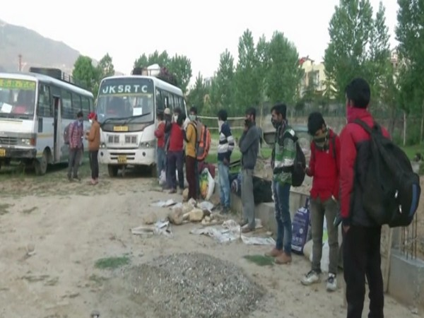 Migrant workers leaving the quarantine facility in Doda. Photo/ANI