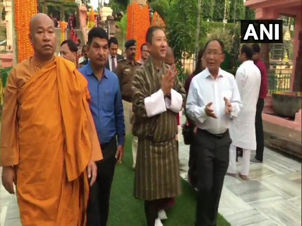 Bhutan Foreign Minister Tandi Dorji (C) at the Mahabodhi Temple in Bodh Gaya on Tuesday.