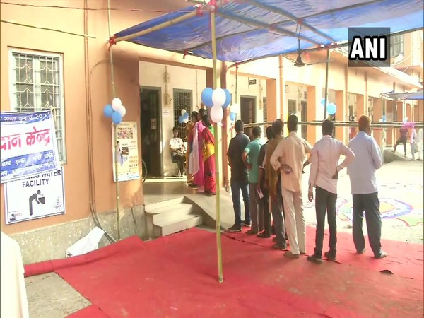 People queue up outside polling station in Dumka, Jharkhand.