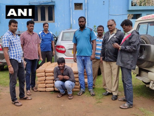 Task Force police along with the arrested persons. (Photo/ANI)