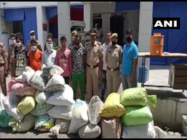 The police team with the nabbed accused and seized drugs on Thursday. Photo/ANI