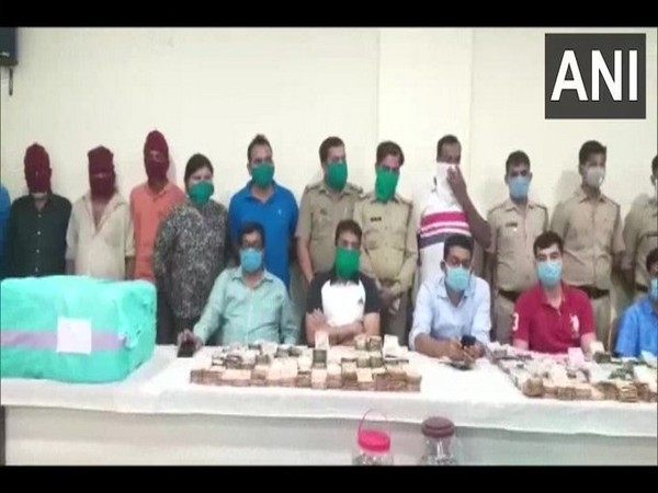 The police team with the arrested accused, and the drugs and cash recovered in the bust. Photo/ANI