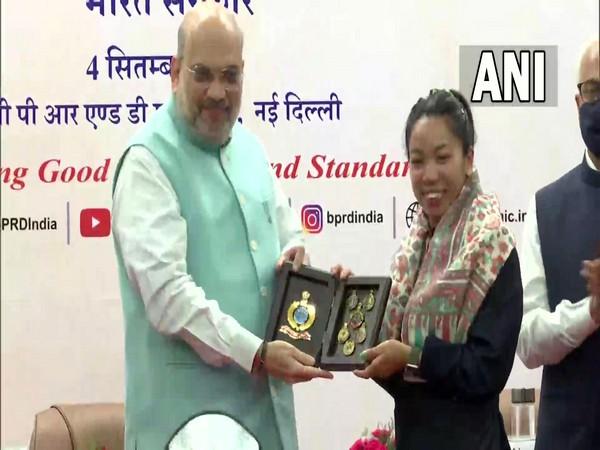 Union Home Minister Amit Shah felicitating Olympics medalist Mirabai Chanu in Delhi. (Photo/ANI)