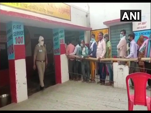 People queue up to cast their votes for the fourth phase of UP Panchayat polls in Sambhal. [Photo/ANI]