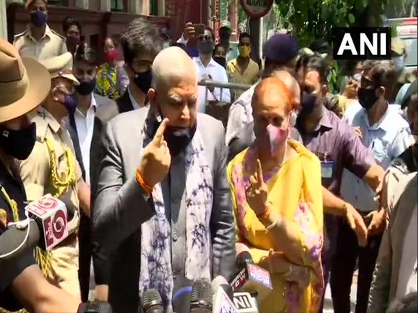 West Bengal Governor Jagdeep Dhankhar and his wife Sudesh Dhankhar cast their votes at a polling booth in Chowringhee, Kolkata on Thursday. [Photo/ANI]