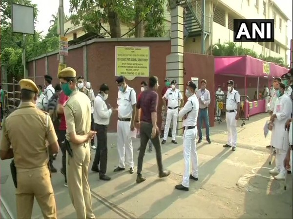 Officials and counting agents arriving at a counting centre in Kolkata on Sunday. [Photo/ANI]