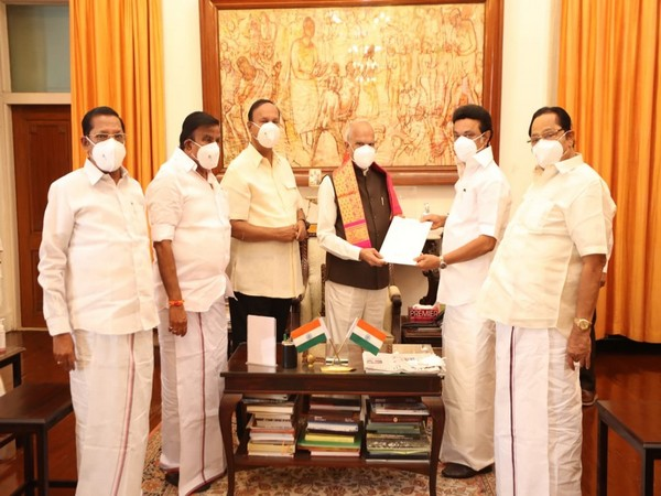 MK Stalin handling over a resolution to Governor Banwarilal Purohit.