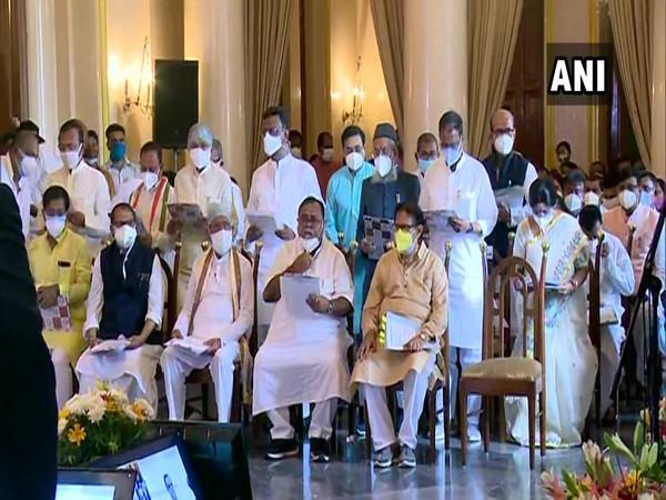 TMC leaders taking oath at Raj Bhavan in Kolkata. (Photo/ANI)
