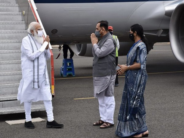 PM Narendra Modi reached Gujarat  to review damage (photo/Twitter)