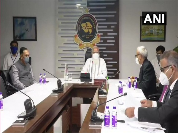 Prime Minister Narendra Modi (centre), Gujarat Chief Minister Vijay Rupani (left) in Ahmedabad (Photo/ANI)