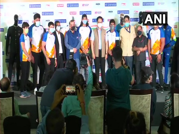 Sports Minister Kiren Rijiju and athletes after unveiling India's Olympic uniform