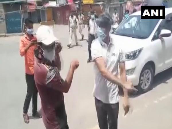 Still from the viral video of IAS Ranbir Sharma slapping a man. (Photo/ANI)