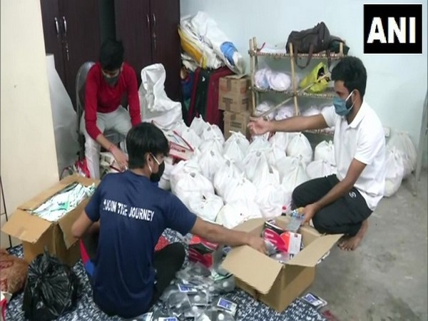 Rugby players help families by providing oxygen cylinders and ration