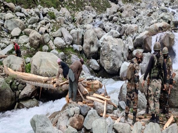 Amid heavy rain and freezing temp at 9000 ft, Indian Army constructs footbridge washed away last night in J-K's Rajouri. [Photo/ANI]