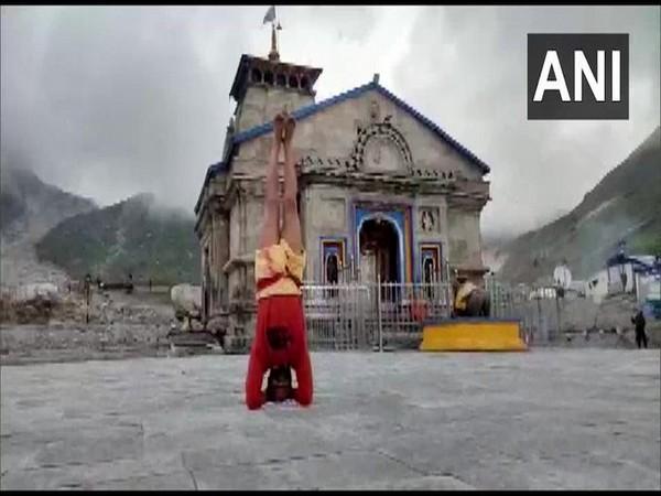 Acharya Santosh Trivedi of Kedarnath Dham in Sirsasana position outside Kedarnath Shrine. (Photo/ANI)