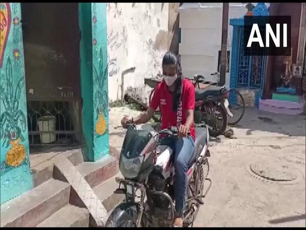 Bishnupriya Swain on her bike delivering food. (Photo/ANI)