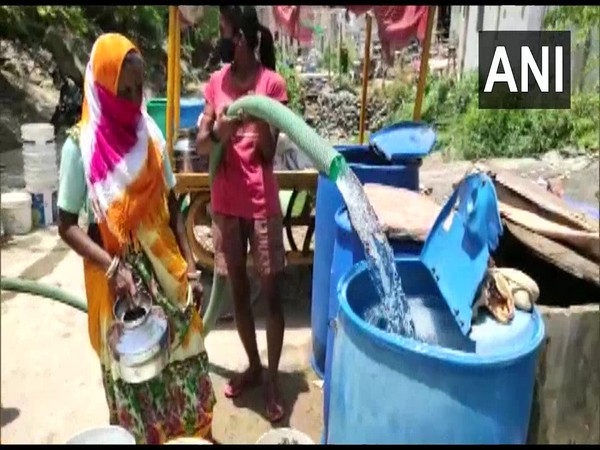 People living in the rural areas storing water in their tankers (Photo/ANI)