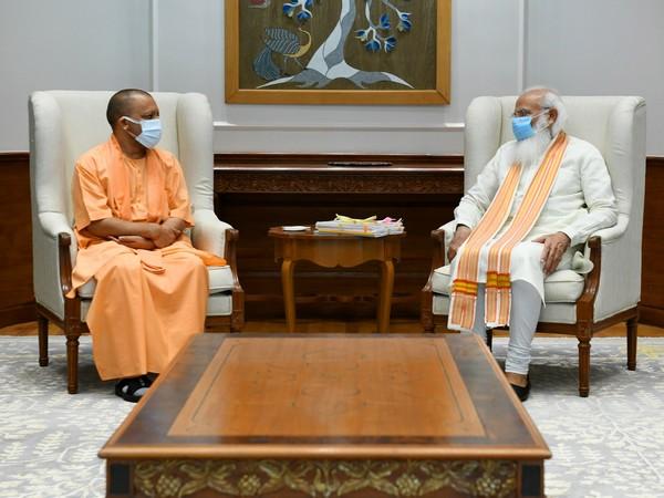 Uttar Pradesh Chief Minister Yogi Adityanath (L), Prime Minister Narendra Modi (R) in Delhi (Photo/ANI)
