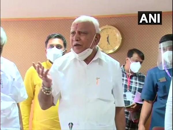 Karnataka Chief Minister BS Yediyurappa speaking to reporters in Hassan on Friday. [Photo/ANI]