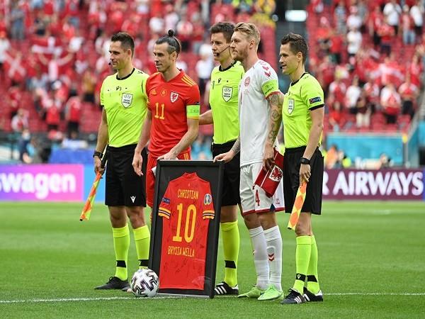 Kjaer, Gareth Bale and match officials  (Image: UEFA Euro 2020's Twitter)