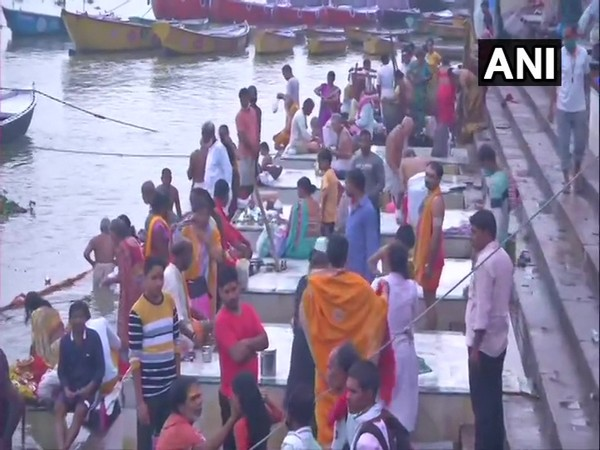Devotees assemble at the Ganga ghat on the occasion of Ganga Dussehra in Varanasi on Sunday. [Photo/ANI]