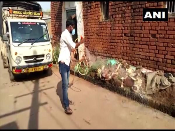 COVID-19 taskforce sanitizing Allapur village in Karnataka (Photo/ANI)