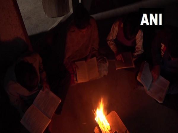 Students of Ladha studing using firewood (Photo/ANI)