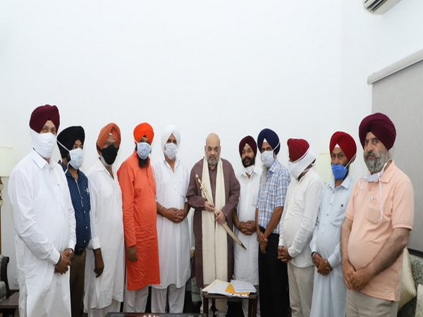 Amit Shah meets All Sikh Gurdwara Management Committee delegation from Kashmir, in New Delhi on Sunday.